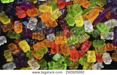 Colored gelatinous on a black background close-up. poster