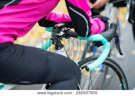 Two Young Female Cyclists with Road Bicycles Resting and Having Fun in the Park in the Cold Autumn Day. Healthy Lifestyle Concept.
