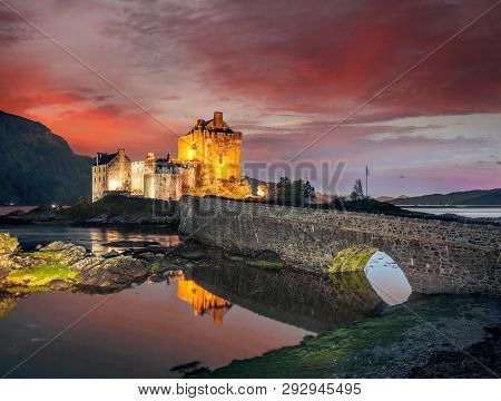 The Eilean Donan Castle With Colorful Sunset, Highlands Of Scotland