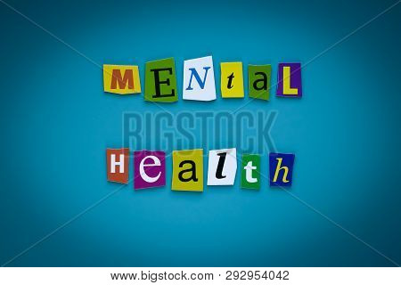 A Word Writing Text - Mental Health - Of Cut Letters On A Blue Background. Headline - Mental Health.
