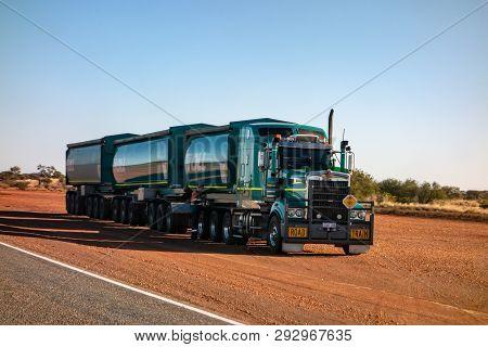 Western Australia - July 11, 2019: Green Kenworth Heavy Road Train Truck Of The Toll Company Transpo
