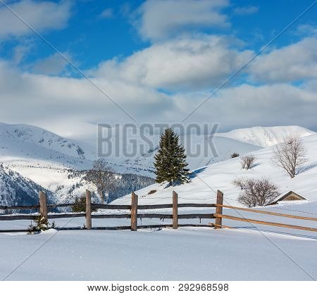 Winter  Morning Scenery Picturesque Mountain Hill Top With Farmstead Snow Covered (ukraine, Carpathi