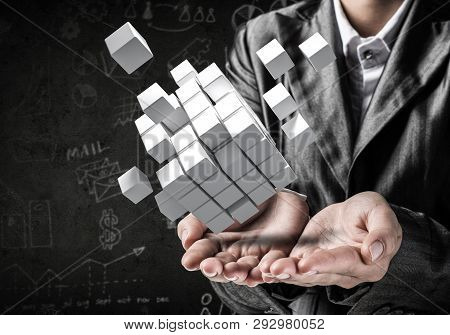 Cropped Image Of Business Woman In Suit Presenting Multiple Cubes In Hands As Symbol Of Innovations.