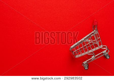 Pushcart On Red Background With Some Copy Space. Top View Of Red Pushcart. Overturned Red Pushcart.