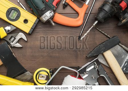 Different Construction Tools On Wooden Background With Copy Space. Top View Of Diy Construction Tool