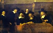 """Rembrandt van Rijn (1606 -1669) """"Syndics of Draper's Guild"""" Reproduction from illustrated Encyclopedia «Art galleries of Europe», Partnership «M. O. Wolf», St. Petersburg - Moscow, Russia , 1901 poster"""