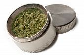 Metal marijuana grinder placed on a white background poster