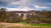 Disused Edlingham Railway Viaduct, originally opened in 1887 and is located near the hamlet of Edlingham in Northumberland, Northeast England poster