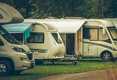 RV Park Camping. Modern Recreational Vehicles on the Campsite. Motorhomes and Travel Trailers. poster