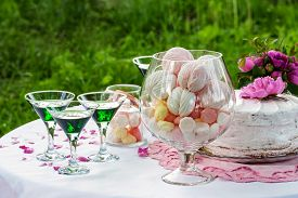 Wedding Candy Bar With Drinks, Decorated With Flowers Outdoors