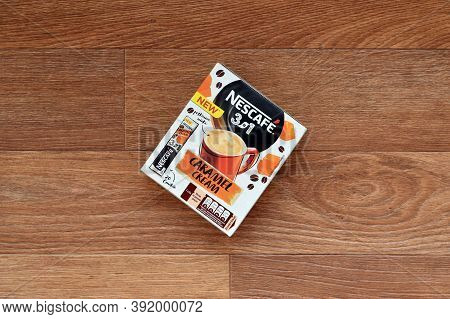 Nescafe Caramel Cream Coffee Sticks Box On Wooden Background. Nescafe Is A Brand Of Coffee Made By N