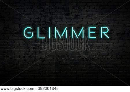 Neon Sign With Inscription Glimmer Against Brick Wall. Night View