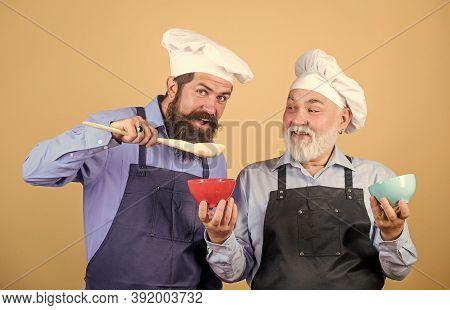 Eat Concept. Mature Bearded Men Professional Restaurant Cooks. Delicious Recipe. Kitchen Team Prepar