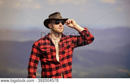 Time Spending. Sexy Macho Man In Checkered Shirt. Man On Mountain Landscape. Camping And Hiking. Tra