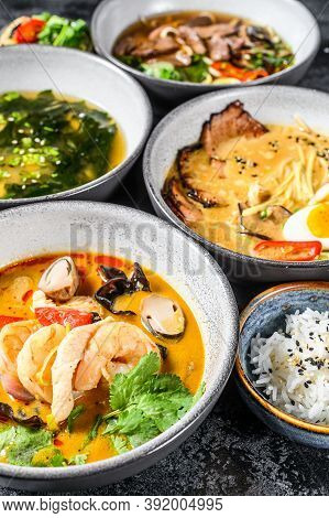 Asian Soups, Miso, Ramen, Tom Yam, Pho Bo. Black Background. Top View