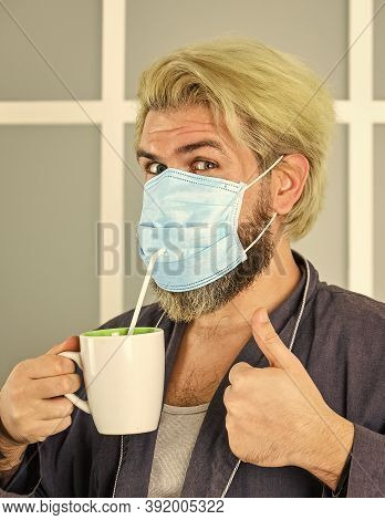 Masks To Protect From Virus. Man Wears Mask To Protect From Viral Infection. Man Drinks Coffee In Me