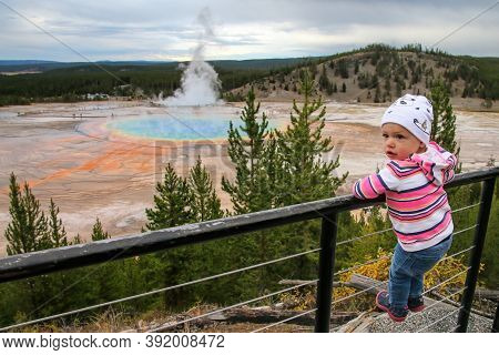 Toddler Girl Standing At Grand Prismatic Spring Overlook, Midway Geyser Basin, Yellowstone National