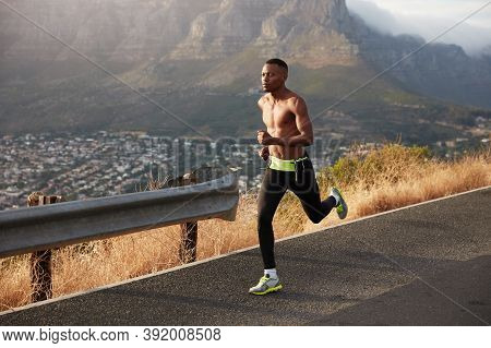 Healthy Lifestyle Banner Panorama. Fast African American Man Has Cardio Running, Poses Outside, Wear