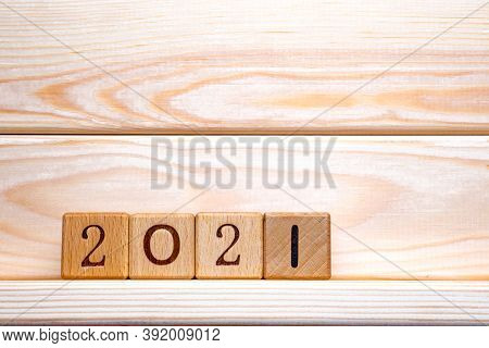 2021 Text On Wooden Cubes On Wood Background, Table. 2021 New Year Abstract Design Concept. Closeup