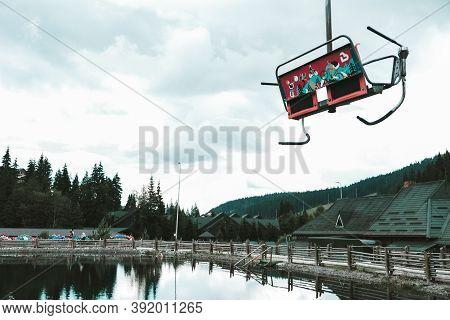 Bukovel, Ukraine - July 2020: Empty Chairlift Going Up In Summer At A Popular Ukrainian Ski Resort B