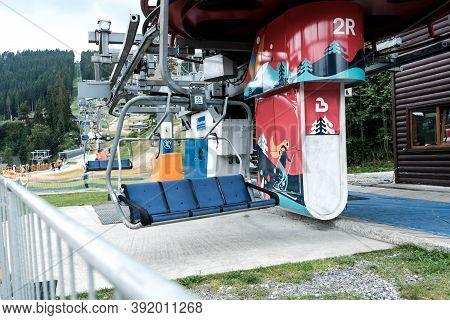 Bukovel, Ukraine - July 2020: Empty Ski Lift Or Chairlift At Ukrainian Resort Bukovel In Summertime.