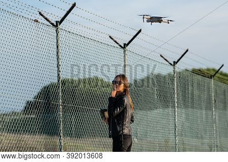 Woman Flying Drone In Forbidden Zone. Fly Without A License. Fly Drone Near Airport. Drone Legislati