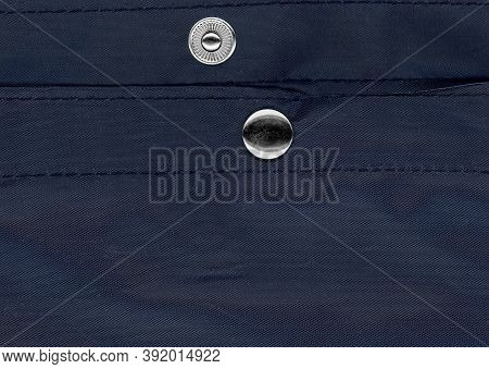 Snap Fastener On Blue Bag Fabric Texture