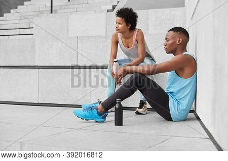 View Of Pensive Youngsters Have Sporty Body Shape, Motivation To Be Healthy And Fit, Do Sport In Ope