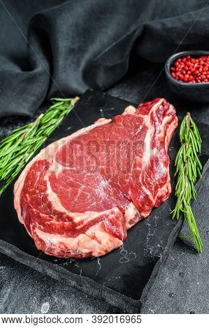 Rib Eye Or Cowboy Steak. Raw Marble Beef Black Angus, Ribeye. Back Background. Top View
