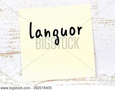 Yellow Sticky Note On Wooden Wall With Handwritten Inscription Languor
