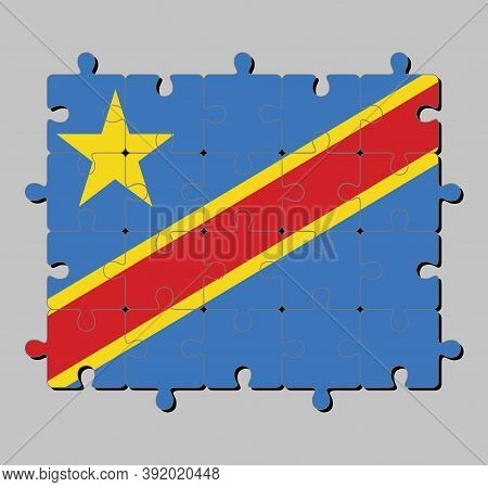 Jigsaw Puzzle Of Dr Congo Flag In Sky Blue Field With Diagonally Red And Yellow Stripe And Star. Con