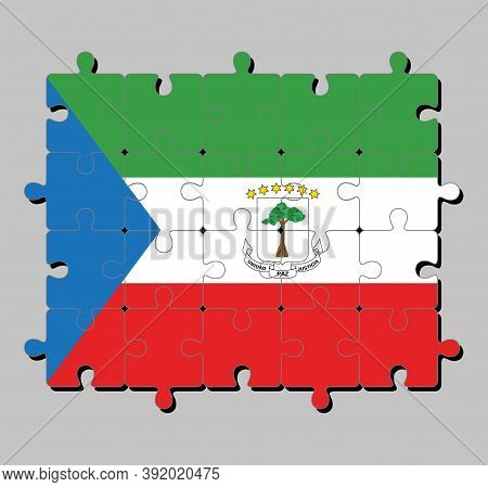 Jigsaw Puzzle Of Equatorial Guinea Flag In Tricolor Of Green White And Red With A Blue Triangle And