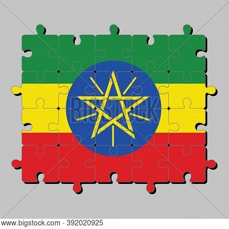 Jigsaw Puzzle Of Ethiopia Flag In Tricolor Of Green Yellow And Red With The National Emblem. Concept