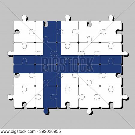 Jigsaw Puzzle Of Finland Flag In Sea Blue Nordic Cross On A White Field. Concept Of Fulfillment Or P