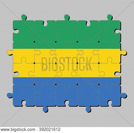 Jigsaw Puzzle Of Gabon Flag In A Horizontal Triband Of Green, Gold And Blue. Concept Of Fulfillment