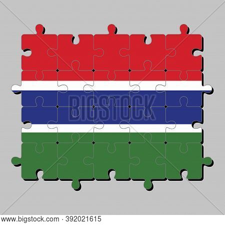 Jigsaw Puzzle Of Gambia Flag In Red Blue And Green Color And Separated By A Narrow Band Of White. Co