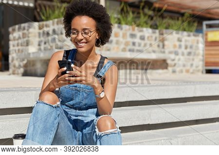 Satisfied Blogger Texts Funny Message For Post On Personal Website, Dressed In Ragged Overalls, Send