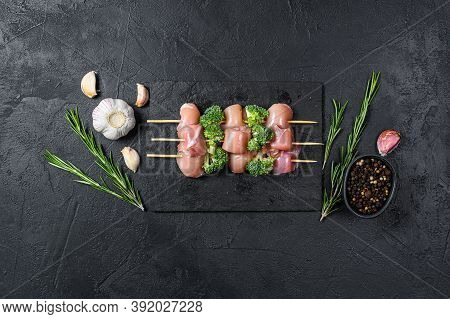 Raw Chicken Shish Kebab With Broccoli, Barbecue. Black Background. Top View