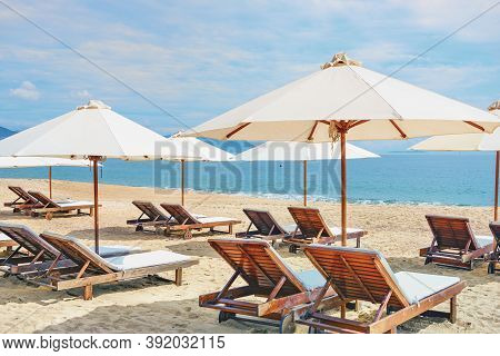 A Lot Of White Beach Sun Lounger With Umbrella At The Deserted Sea Beach. Vietnam, Nha Trang