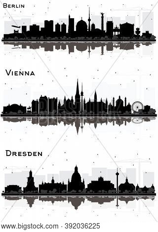 Vienna Austria, Berlin and Dresden Germany Skyline Silhouettes Set with Black Buildings and Reflections Isolated on White. Cityscapes with Landmarks.