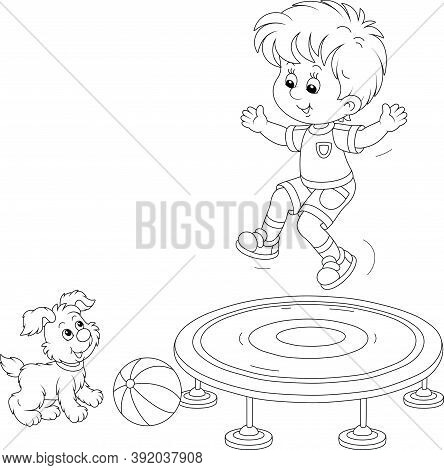 Cheerful Little Boy Jumping On A Toy Trampoline On A Playground, A Small Cute Pup Looking At Him, Bl