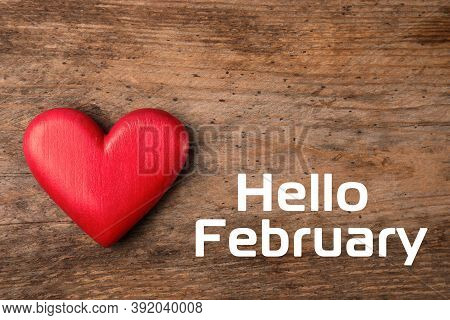 Greeting Card With Text Hello February. Red Decorative Heart On Wooden Background, Top View