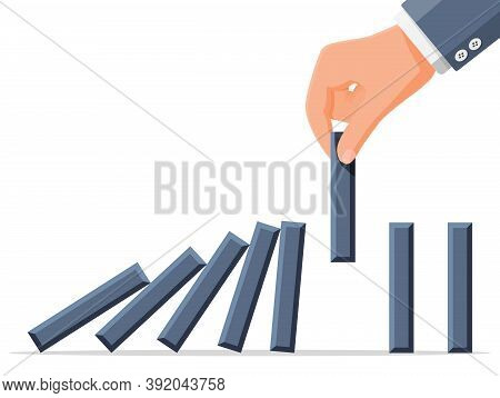 Businessman Hand Stopping Domino Effect. Business Man Stops Falling Dominoes With Finger. Finishing
