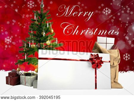 Various Christmas Items And A Gift Card On Wintery Background