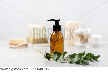 Concept Of Biodegradable Cosmetics. Selective Focus On Glass Dispenser Bottle With Natural Soap, Org