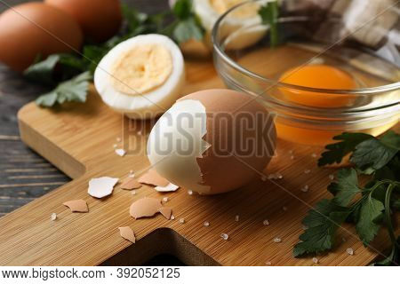 Board With Boiled Eggs, Napkin And Parsley On Wooden Background