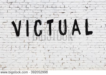Inscription Victual Written With Black Paint On White Brick Wall.