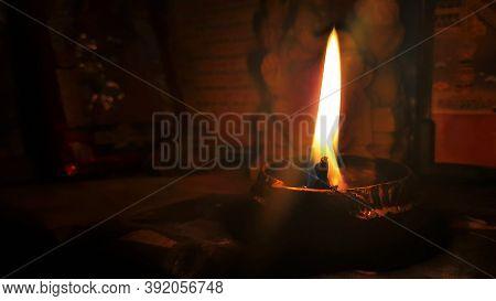 Lighten Metal Lamp Glowing Flame In Dark Background