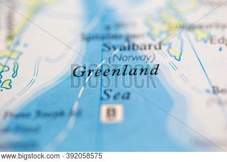Shallow Depth Of Field Focus On Geographical Map Location Of Greenland Sea Off Coast Of Greenland On