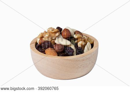 Mixed Various Nut And Raisin Snack In Wooden Bowl, Super Food, Isolate Background